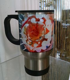 Stainless steel travel mug w/original artwork by PatriciaDee. Perfect stocking stuffer for the discerning commuter on your list! Only $18 at Image Awards, Engraving & Creative Keepsakes, Inc.