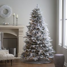 7.5 ft. Pre-lit Natural Cut Flocked Vermont Spruce Christmas Tree by Sterling Tree Company
