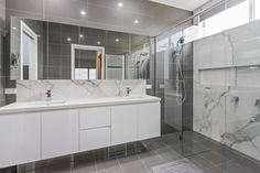 The geometric elements utilised throughout this bathroom, in the cabinetry, tiles and shelf in the shower recess, create a holistic design. Shower Recess, Cabinet Design, Melbourne, Cabinets, Tiles, Custom Design, Shelf, New Homes, Interiors