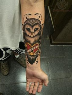 Red Heart And Owl Tattoo On Arm