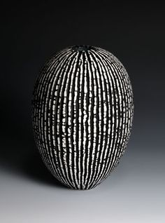 Ceramics by Peter Beard at Studiopottery.co.uk - 2011. Black and White thrown vessel. 29cm. high