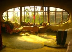 This looks so cozy.. The living room of an underground house