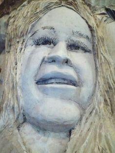 Woman in wood favors  Janis Joplin