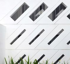 Perforated west facing concrete wall shields the Alam Residence, Jakarta. By ID-EA.