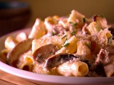 Rigatoni with Creamy Mushroom Sauce from CookingChannelTV.com - sauté thin chicken breasts with garlic, salt and pepper; sauté peppers, onions and mushrooms and add to sauce.