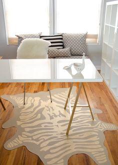 home office inspiration, with Ikea expedits, trestle leg desk, and gold accents of course