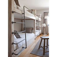 Flight attendant crash pad. This is how you do bunk beds for adults, stylish adults!