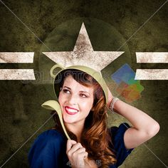 stock photo of brunette woman with ladle wearing colander as helmet with airforce logo background