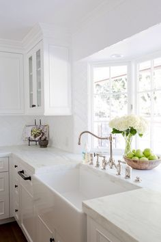 A gorgeous farmhouse sink is paired with an antique polished nickel faucet mounted in front of a bay window to a honed white marble countertop accenting white cabinets adorning oil rubbed bronze hardware. - My Interior Design Ideas Farmhouse Sink Kitchen, Home Kitchens, Kitchen Remodel, Kitchen Design, Farmhouse Kitchen, White Kitchen Design, Kitchen Cabinets Decor, Home Decor, Cabinet Decor