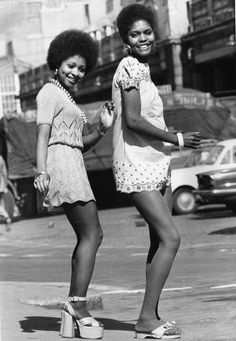 Two models, photographed in 1973, wearing mini dresses, one with platform sandals, the other in flat exercise sandals. - Graham Wood / Evening Standard / Getty Images