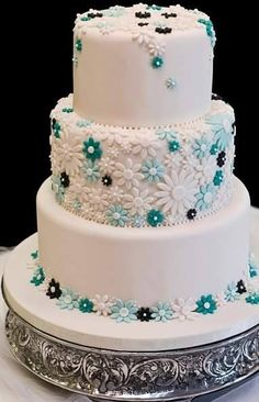 Turquoise, white black flowers cake