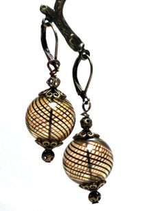 Check these out in person at TCH's Vintage Jewelry Sale and Tea where Shawneliza Creations will be a vendor. Brown and Black Blown Glass Leverback Earrings Lever Back Stripe Stripes Round Bronze by @Shawn Mackey