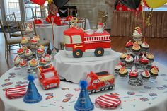 I made this fire truck cake with matching cupcakes complete with dalmation puppy and fire hose on top!