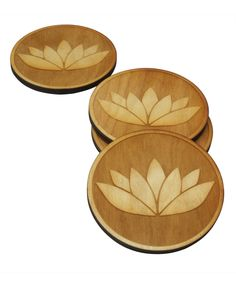 Set of four coasters made cut to in the USA from Baltic Birch wood are designed and cut to depict a blooming beautiful lotus flower.