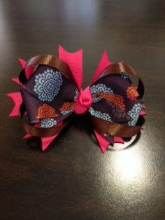 A 4 inch patterned grosgrain hair bow with brown loops and pink spikes by BrinleysBowtique32, $5.50