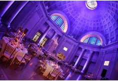 Franklin Institute Wedding Reception | Marie Labbancz - Art Of Love Blog Nancy Saam Flowers Blue and Pee Gee hydrangea with apricot roses. Tall taper beeswax candles graced the low centerpieces.