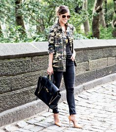 """@Who What Wear - How To: Spice Up An All-Black Outfit                 Fashion Tip: Throw a bold print like camouflage or leopard into the mix to break up the color monotony and catch the eye.    Camera Tip: """"A nude or metallic heel is your best friend. The shoe will disappear and you'll photograph like you've got legs for days (even if you don't!)."""""""