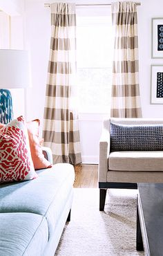 Home Tour: Traditional With a Fresh Modern Twist //  traditional, West Elm striped curtains, blue sofa, Manuel Canovas Frida fabric, blue glass table lamp