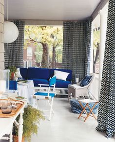 Outdoor patio curtains using ceiling mounted curtain tracks!