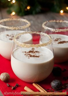 'Tis the season for delicious holiday inspired drink ideas, especially this one: Spiced Eggnog Cocktails. Sugar-rimmed glasses and a pop of nutmeg make this the perfect adult treat for your next Christmas party.