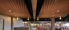 Custom commercial wood ceilings from Armstrong Ceiling Solutions are just that: made-to-order wood ceilings in unique designs, sizes, shapes to create unique spaces. Wood Slat Ceiling, Drop Ceiling Tiles, Dropped Ceiling, Ceiling Panels, Wood Ceilings, Wood Slats, Custom Wood, Track Lighting, Woodworking