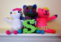 Stitch11 crochet cats:  See other post for pattern--this post for hello kitty color inspiration :)