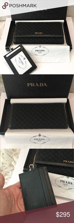 "Prada Black Quilted Nylon & Leather ID Card Wallet Authentic Prada Black Nylon Quilted ID Chain Card Holder Wallet.  This wallet has been used 1 time, very good condition. Very minimal, unnoticeable tarnish to Prada logo at front if you look closely at the photo.  Chain attaches to wallet with ID Card Holder to make this truly functional.  Black leather trim, dual snap closure. Gold hardware. Comes with box, box is slightly damaged as photoed in corners.  Measures approx 7.5"" x 4"". Prada…"