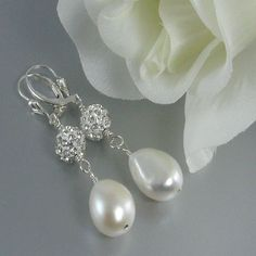 Pearl earrings made with white baroque cultured pearls, crystal pave balls and sterling silver lever back earring wire. BUY NOW http://jewelrybytali.com/products/crystal-pave-white-baroque-pearl-earrings-bridal-earrings-wedding-earrings