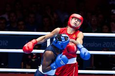 Boxing: Sweden's Ana Laurell (red) and Claressa Shields, (blue)
