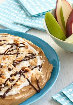 Layered Peanut Butter Dessert Dip – Peanut butter topped with marshmallow creme, whipped topping, toasted coconut and chocolate makes a scrumptious dessert dip for apples, cookies and more.