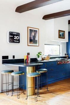 This kitchen has a ton of personality without feeling over-the-top. We love how Open House LA chose leather barstools that don't quite match the blue painted cabinets—the room...