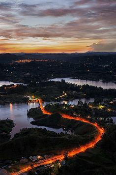 Beautiful South American sunset at the Dam of Guatape (Antioquia, Colombia). View from top of Guatape Rock.