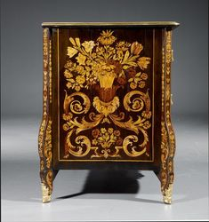 "c1720-30 IMPORTANT COMMODE ""A FLEURS"", so–called ""marqueterie au jasmin"", Louis XIV, from a Parisian master workshop. Ebony, rosewood, maple, amaranth, sycamore and cherry, exquisitely inlaid all–around with flowers, birds, grotesques, mascarons, scrolled leaves and cartouches. Top edged in bronze, curved legs. Front ""en arbalète"" with 3 drawers, the top drawer divided in two. 119x66.5x90 cm. Sold for CHF 52 000 (hammer price)"
