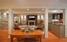 focal point of the basement living area. The rustic wall is extended to a small kitchenette. Stones are also used for the wall facing the stairs. Basement Apartment, Basement Walls, Apartment Kitchen, Basement Ideas, Basement Inspiration, Basement Flooring, Basement Bathroom, Apartment Design, Basement Renovations