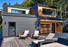 floating-wooden-one-bedroom-cabin-with-integrated-boathouse-4-decks-windows.jpg