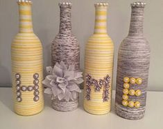 Yarn wrapped bottles wine bottles wrapped bottles with #DIYHomeDecorWineBottles
