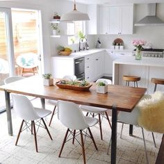 The wood and white kitchen of our dreams ✨ So much weekend inspiration! Shop this cream color Carry A Torch rug with link. Dining Room Inspiration, Home Decor Inspiration, Kitchen Dining, Kitchen Decor, Dining Decor, Home And Living, Home Kitchens, Home Remodeling, Home Accessories
