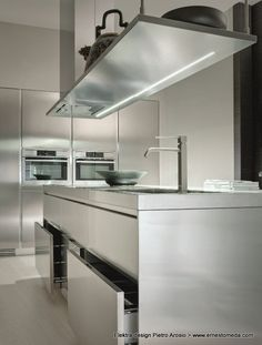 would like the kitchen installer to make a pair of stainless steel panels for the sides of the unico hood;  like open shelving next to hood;  like under shelving lighting   --- --- --- Elektra design Pietro Arosio