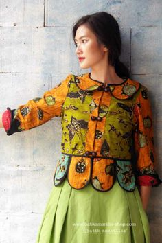 Batik Amarillis' Piccola jacket in jewel colored batik wonogiren -Indonesia ..Take a fresh, sweet & whimsical approach to power dressing with this Krakow-Poland classic traditional folklore inspired jacket . The beauty essential is reworked with a contrast-coloured batiks,unique cuttings ,trims,glossy beaded buttons,it has fitted waist with unique peplum petals.