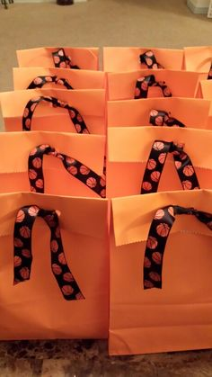 Daughters Basketball Birthday Party Gift Bags DYI Ribbon, Paper bags, ring pops, fun dip and basketball theme toys.