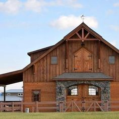 Denali 36 - Barn Pros. Good mixture of stone and wood siding. Love timber frame designs.