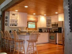 White cabinets in wood cabin kitchen - Modern Pine Kitchen, Home Decor Kitchen, Kitchen Design, Kitchen White, Kitchen Ideas, Knotty Pine Decor, Knotty Pine Walls, Cabin Kitchens, Oak Kitchens