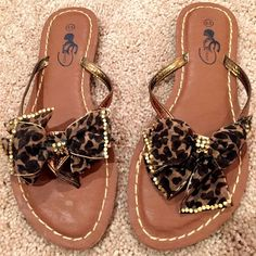 Brown Leather Thong Sandals with Cheetah print bow Brown Leather Thong Sandals with Cheetah print bow. Never worn, tag still on the bottom sole. Size: 6 1/2. Shoes Sandals