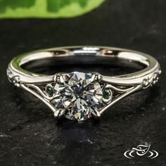 Like this ring, just put diamonds where the emeralds are