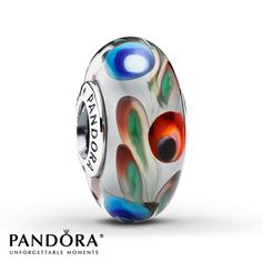 Blue, red and green swirls trail through white Murano glass in this sterling silver charm from the Pandora Fall 2013 charm collection. Style # 791614.