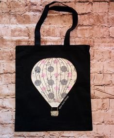 Our popular Vintage Hot Air Balloon graphic has made a come back! This versatile black tote is a perfect fall transition piece. A Rose Gold Vintage exclusive! Cotton, tote measures by Unusual Wedding Gifts, Best Wedding Gifts, Marriage Gifts, Wedding Favor Bags, Baby Shower Balloons, Engagement Gifts, Hot Air Balloon, Small Bags, E Design