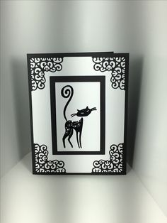Handmade cat card with Downtown Abbey Opulent Corners and Hero Arts Infinity rectangle dies. Inkadinkado Cattitude cat stamped with VersaMark and embossed with Zing black embossing powder.