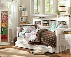A single bed & trundle with surround shelves