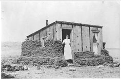 Margaret Bramer (later Mrs. Otto Hanson) in her homestead shack in South Dakota.      Thousands of single women traveled west to stake their claim to a homestead in the post-Civil War period.