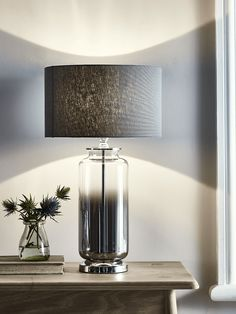 Finished with a mid-grey linen shade and pewter toned base, our statement table lamp features a tapered smoky grey glass base with a softly dimpled effect finish. Table Lamps Uk, Luxury Table Lamps, Ceramic Table Lamps, Room Lamp, Bed Room, Desk Lamp, Large Lamps, Contemporary Table Lamps, Grey Glass